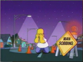 image of Homer Simpson by construction sign reading Man Sobbing